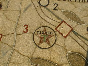 Faded Texaco logo in terazzo